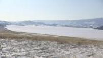 Skaters on the frozen lake Baikal