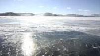 Blizard on the frozen lake Baikal