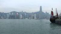 Boats in the bay of Hong Kong at dusk
