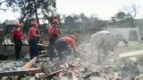Greek fires rescuers seek missing