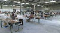 Workshop for manufacturing fabric masks