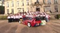 Sébastien Loeb and his Citroen C4 received at Matignon