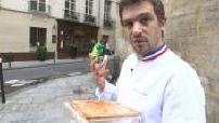 The chef Arnaud Nicolas prepare the pie in his Paris restaurant