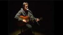 """Jean-louis Murat performing """"Tout est dit"""" on the acoustic guitar"""