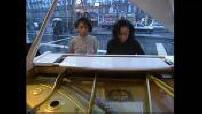 Native interpreting piece at the piano